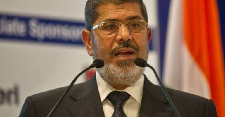 Egyptian President Mohamed Morsi addresses a gathering during India-Egypt Economic Forum in New Delhi on March 20, 2013.  By Manan Vatsyayana (AFP)