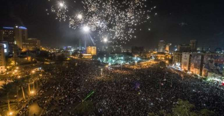 Egyptians celebrate in Cairo's Tahrir Square on June 3, 2014 after ex-army chief Abdel Fattah al-Sisi the presidential election.  By Khaled Desouki (AFP/File)