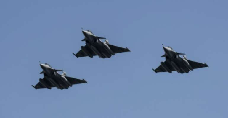 Egypt shows off three Rafale fighter jets newly delivered in 2015 under a previous deal with French defence firm Dassault Aviation.  By KHALED DESOUKI (AFP/File)