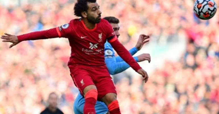 Egypt star Mohamed Salah (L) wins a heading duel during the Premier League draw between Liverpool and Manchester City at the weekend..  By Paul ELLIS (AFP)
