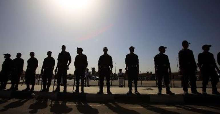 Egyptian police stand guard outside the police academy in Cairo on September 27, 2014.  By Mohamed el-Shahed (AFP)