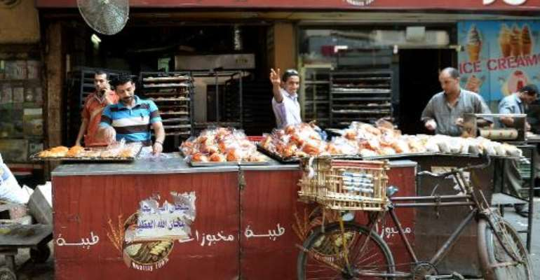 Egyptian bakers prepare croissants at a bakery in a popular Cairo street on August 26, 2013.  By Marwan Naamani (AFP/File)