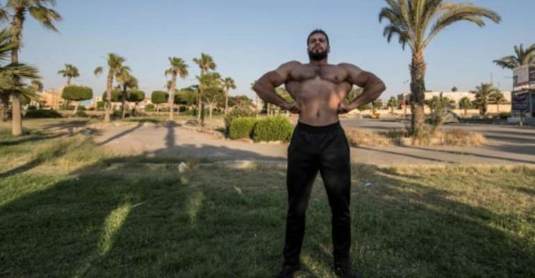 Egyptian bodybuilders say they are raring to get back to their gruelling gyms routines after being on virus lockdown for weeks.  By Khaled DESOUKI (AFP)