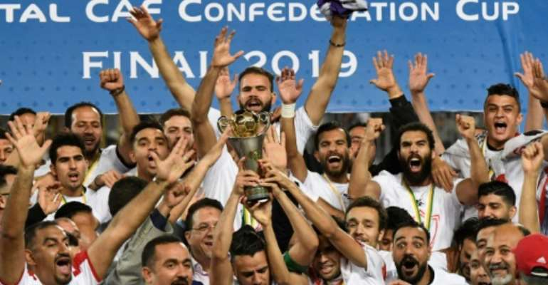 Egyptian club Zamalek celebrate winning the 2019 CAF Confederation Cup. They will not defend the title having qualified for the richer CAF Champions League.  By Khaled DESOUKI (AFP)