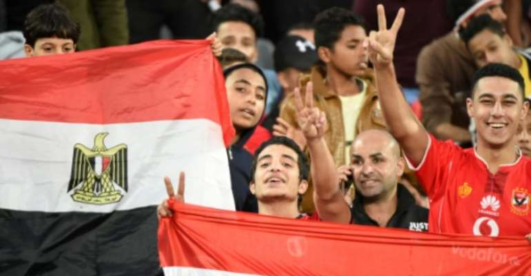 Egyptian fans cheer for their team ahead on an Africa Cup of Nations qualifier football match against Tunisia at the Borg El Arab Stadium near Alexandria on November 16, 2018.  By KHALED DESOUKI (AFP/File)