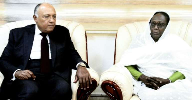 Egyptian Foreign Minister Sameh Shoukry met Sudanese officials including the country's first female foreign affairs minister, Asma Mohamed Abdalla.  By Ebrahim HAMID (AFP)