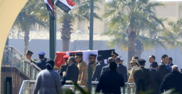 Egyptian honour guards carry the coffin of former president Hosni Mubarak before his funeral ceremony at Cairo's Mosheer Tantawy mosque in Cairo.  By Khaled DESOUKI (AFP)