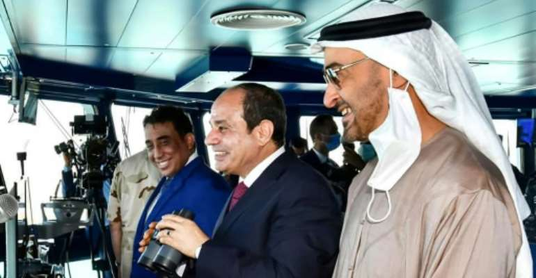 Egyptian President Abdel Fattah al-Sisi (C)inaugurates a new naval base on the Mediterranean Sea flanked by Abu Dhabi Crown Prince Sheikh Mohammed bin Zayed Al-Nahyan (R).  By - (EGYPTIAN PRESIDENCY/AFP)