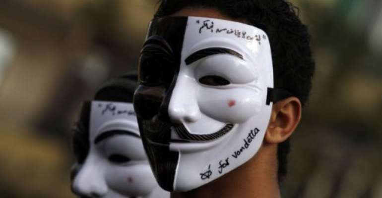 An Egyptian youth wears a mask during a demonstration in Cairo's Tahrir Square on January 31, 2013.  By Mohammed Abed (AFP)