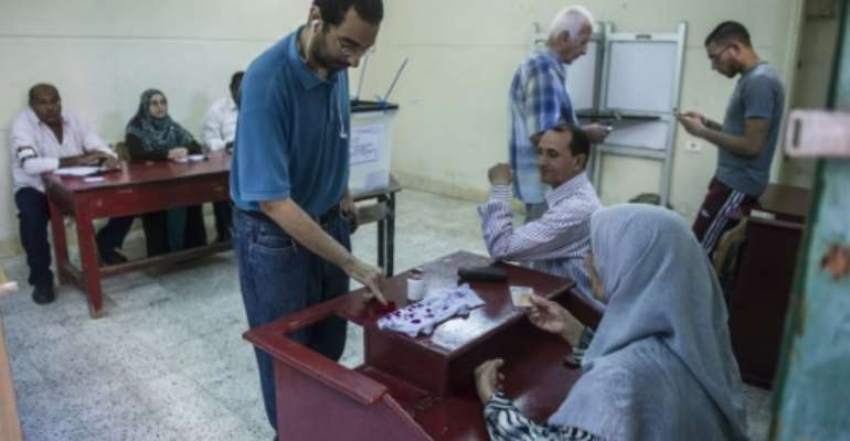 Turnout for the first round of voting held in 14 of Egypt's 27 provinces last week was just 26.6 percent and there was no immediate indication that more voters were casting their ballots Tuesday.  By Khaled Desouki (AFP/File)