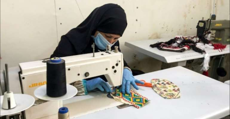Egypt's Bedouin textile tradition of tatriz -- weaving and beading rich geometric and abstract designs on garments, cushions and purses -- has been passed down from generation to generation.  By - (El Fayrouz For Environmental & Social & Economic Services Association/AFP)