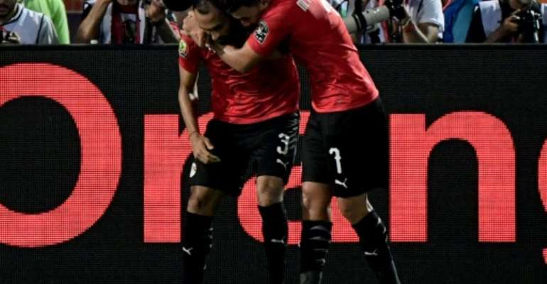 Egypt's defender Ahmed Elmohamady (L) and Mahmoud 'Trezeguet' Hassan starred as Egypt finished Group A with a perfect record.  By JAVIER SORIANO (AFP/File)