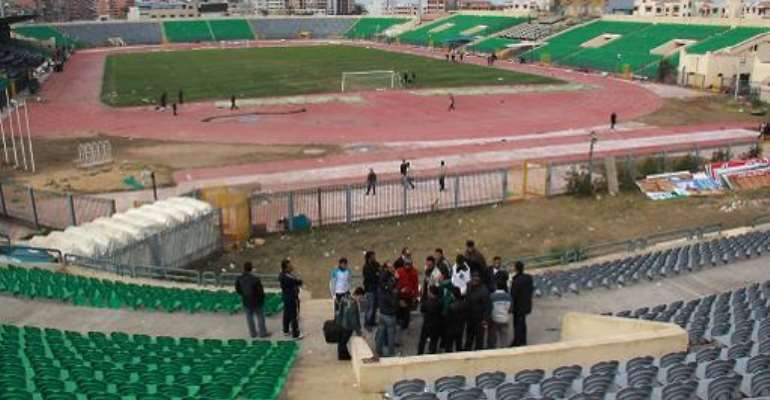 People visit the Port Said Stadium on February 2, 2012, a day after deadly clashes between rival football fans after a match between Al-Ahly and Al-Masry.  By Str (AFP/File)