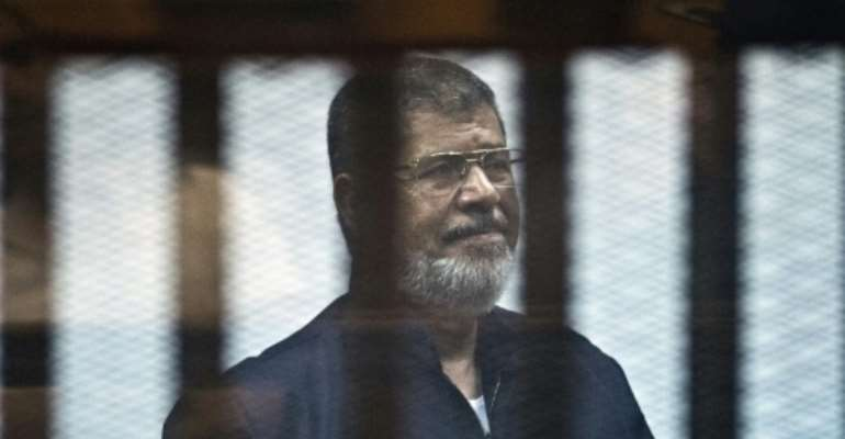 Egypt's former Islamist president Mohamed Morsi had been on trial for espionage when he died on Monday.  By Khaled DESOUKI (AFP/File)