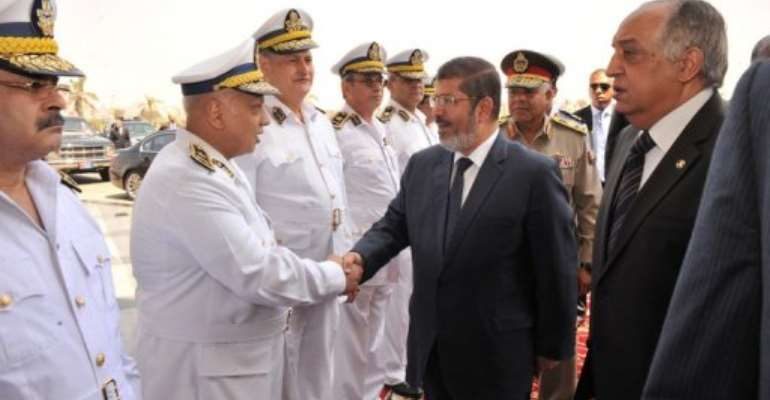 Morsi still has to contend with the Supreme Council of the Armed Forces.  By  (AFP/Egyptian Presidency)