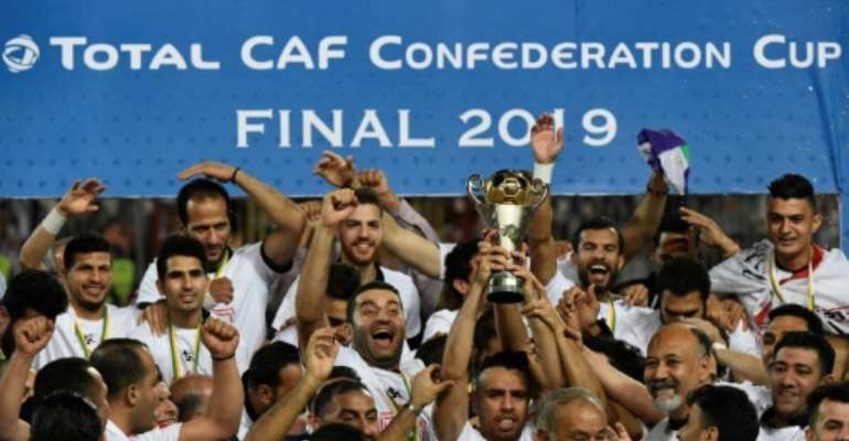 Egypt's Zamalek players celebrate with the trophy after they won the CAF Confederation Cup final on penalties against Morocco's RSB Berkane.  By Khaled DESOUKI (AFP)