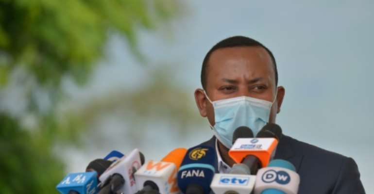 Ehiopia's Prime Minister Abiy said opposition groups that benefited from amnesties he has granted are taking up arms.  By Michael TEWELDE (AFP/File)