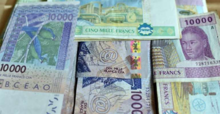 Eight countries in West Africa use the CFA franc. Six other countries use a Central African version of the French-backed currency..  By ISSOUF SANOGO (AFP)