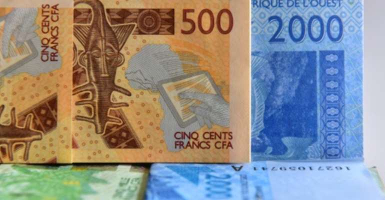 Eight countries use the West African CFA franc -- Benin, Burkina Faso, Ivory Coast, Mali, Niger, Senegal and Togo, which are former French colonies, as well as Guinea-Bissau, a former Portuguese colony.  By ISSOUF SANOGO (AFP/File)
