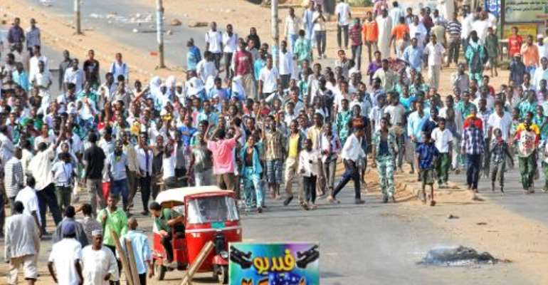 Sudanese protestors demonstrate in Khartoum's twin city of Omdurman after the government announced steep price rises for petroleum products, on September 25, 2013.  By  (AFP/File)