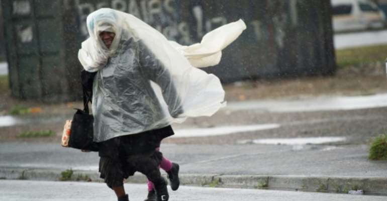 Eight people have died in a ferocious storm that pummelled South Africa's west coast.  By RODGER BOSCH (AFP)