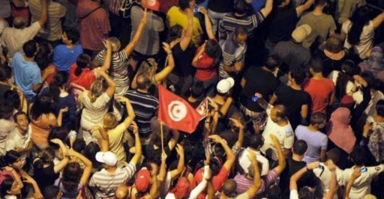 Tunisian protesters gather in front of the Constituent Assembly headquarters in Tunis  on August 4, 2013.  By Fethi Belaid (AFP/File)