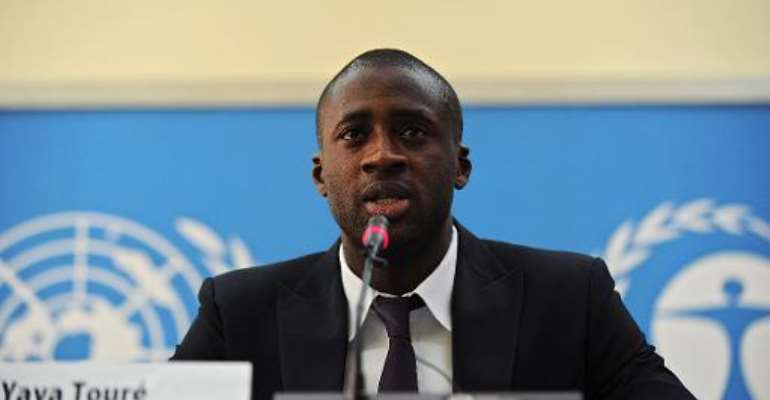 Ivory Coast's football player Yaya Toure speaks during a press conference as he was appointed the United Nations Environment Program goodwill ambassador at the UNEP headquarters in the Kenyan capital Nairobi on October 29, 2013.  By Tony Karumba (AFP)