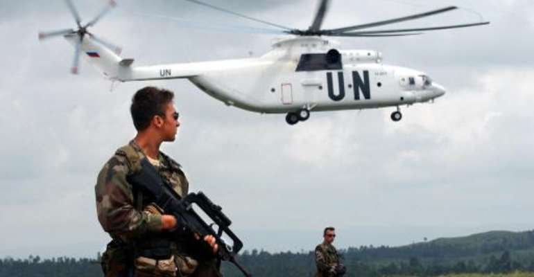 A UN French special forces soldier watches over the situation while a UN helicopter lands on June 10, 2003, on Bunia airport in the Democratic Republic of Congo.  By Eric Feferberg (AFP/File)