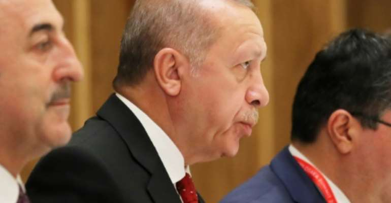 Erdogan (C) supports the internationally recognised national unity government in Tripoli.  By Koji Sasahara (POOL/AFP/File)