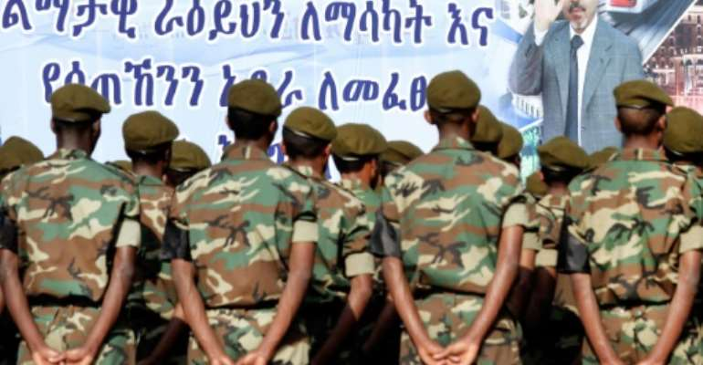 Ethiopian soldiers take part to the official state funeral of Ethiopia's late Prime Minister Meles Zenawi under a giant poster of late strongman in Addis Ababa on September 2, 2012.  By Mulugeta Ayene (AFP/File)