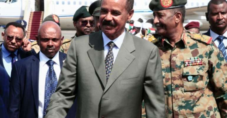 Eritrean President Isaias Afwerki, pictured on a visit to Khartoum in September 2019, has been in power for almost three decades.  By Ebrahim HAMID (AFP/File)