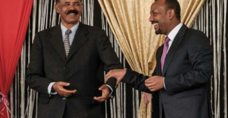 Eritrea's President Isaias Afwerki (L) and Ethiopia's Prime Minister Abiy Ahmed first met last year.  By EDUARDO SOTERAS (AFP/File)