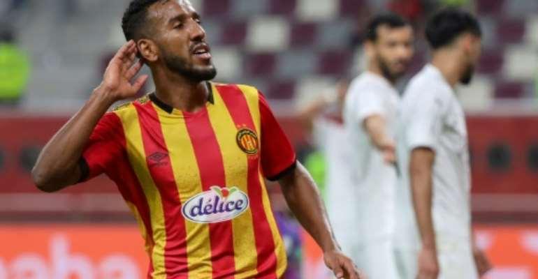 Esperance forward Hamdou Elhouni celebrates completing a hat-trick against Al Sadd of Qatar last week in the Club World Cup.  By KARIM JAAFAR (AFP)