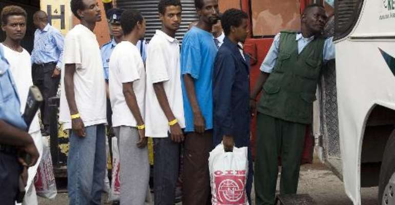 Ethiopian and Somali refugees form a queue to board a bus in the Kenyan port of Mombasa  on November 5, 2010.  By Jean Curran (AFP/File)