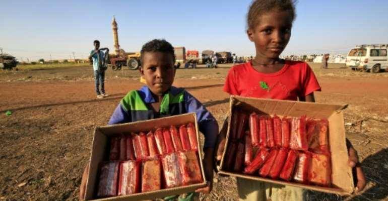 Ethiopian children selling mini cakes in