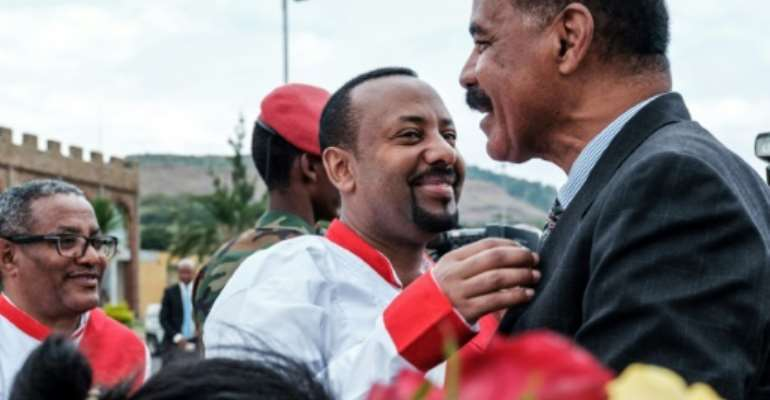 Ethiopian Prime Minister Abiy Ahmed (C) and Eritrea's President Isaias Afwerki embarked on a whip-fast rapprochement last year.  By EDUARDO SOTERAS (AFP/File)