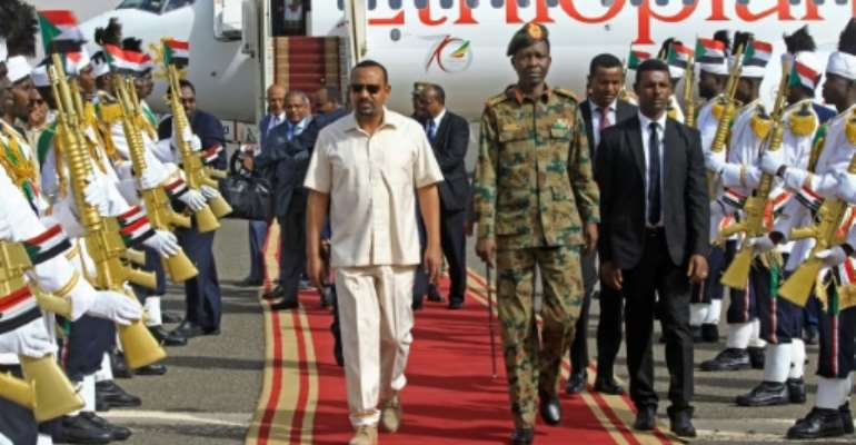 Ethiopian Prime Minister Abiy Ahmed's mission to revive talks between Sudan's military rulers and protest leaders comes days after a deadly crackdown drew international condemnation of the generals.  By ASHRAF SHAZLY (AFP)