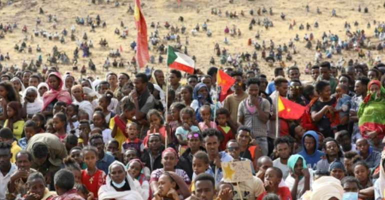 Ethiopian refugees gather to celebrate the 46th anniversary of the Tigray People's Liberation Front at Um Raquba refugee camp in Gedaref, eastern Sudan, on February 19, 2021.  By Hussein Ery (AFP)
