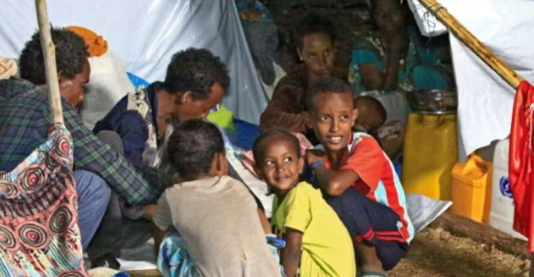 Ethiopian refugees have fled fighting in Tigray province into Sudan.  By ASHRAF SHAZLY (AFP)