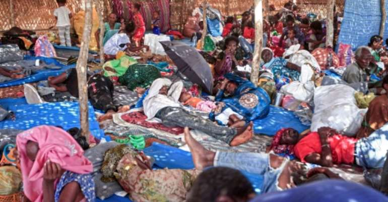 Ethiopian refugees who fled fighting in Tigray province lie in a hut at the Um Rakuba camp in Sudan's eastern Gedaref province.  By Ebrahim HAMID (AFP)