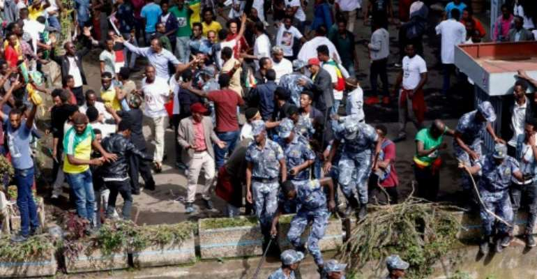 Ethiopian security forces intervene after a blast killed several people during a rally called by Prime Minister Abiy Ahmed.  By YONAS TADESE (AFP)
