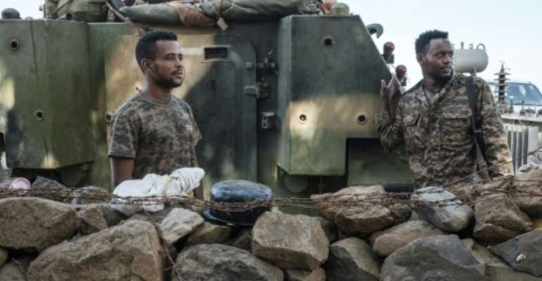 Ethiopian soldiers pictured last November at a military camp in the Tigrayan town Dansha where the first shots in the conflict were reputedly fired.  By EDUARDO SOTERAS (AFP)