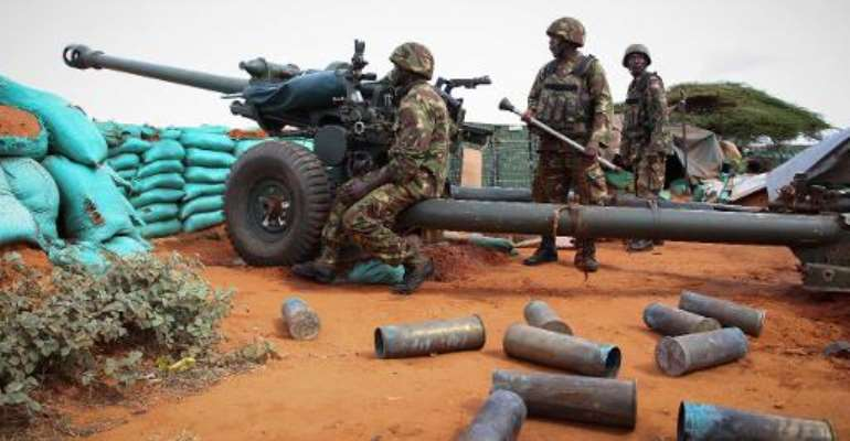 Kenyan soldiers serving with the African Union Mission in Somalia man an artillery position at the Kismayo Airport, on August 22, 2013.  By Ramadaan Mohamed (AU UN IST/AFP)