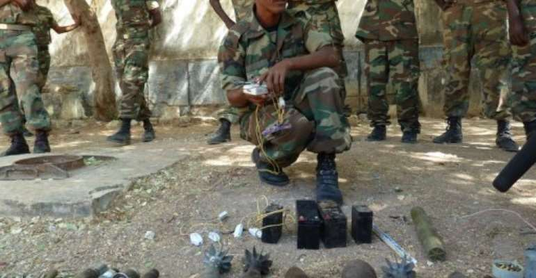 Ethiopian troops display weapons left behind by Somalian Shebab rebels after an earlier defeat this month.  By Jenny Vaughan (AFP/File)