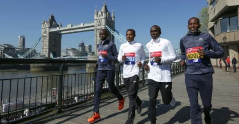Ethiopia's Kenenisa Bekele (second left) will go head to head against Kenya's Eliud Kipchoge (third left) in the 2020 London Marathon.  By Daniel LEAL-OLIVAS (AFP/File)