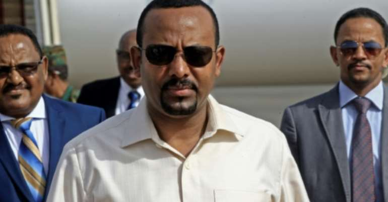 Ethiopia's Prime Minister Abiy Ahmed (C) has denounced attacks on mosques.  By ASHRAF SHAZLY (AFP)