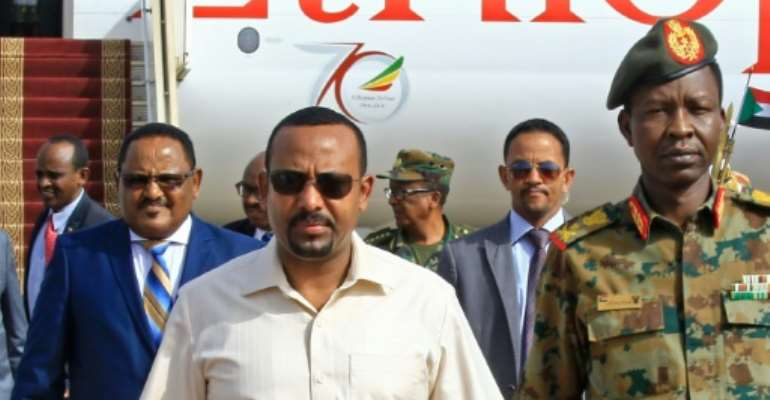 Ethiopia's Prime Minister Abiy Ahmed (C-L) has been praised for his reforms but activists fear a return to repressive tactics after the June attacks.  By ASHRAF SHAZLY (AFP/File)
