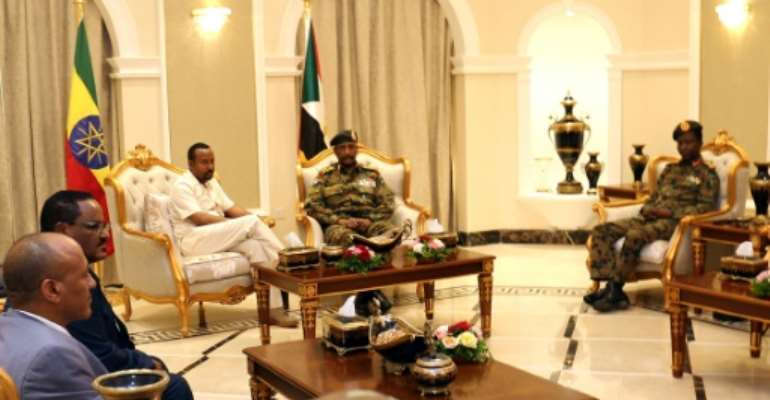 Ethiopia's Prime Minister Abiy Ahmed (C-L) met met separately with Sudan's ruling generals and protest leaders to try and revive talks between the two sides after a bloody crackdown on demonstrators that left dozens dead.  By - (AFP)