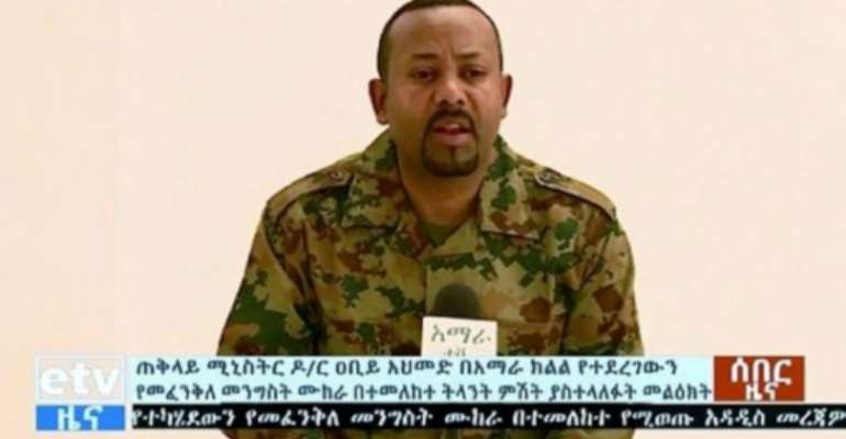 Ethiopia's Prime Minister Abiy Ahmed took to national television dressed in military fatigues and described the situation in Amhara as an attempted coup.  By HO (Ethiopian TV/AFP)