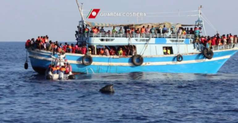 An Italian Coast Guards (Guardia Costiera) video grab released on August 23, 2015 shows migrants on an overcrowded boat off the coast of Libya.  By  (Guardia Costiera/AFP)
